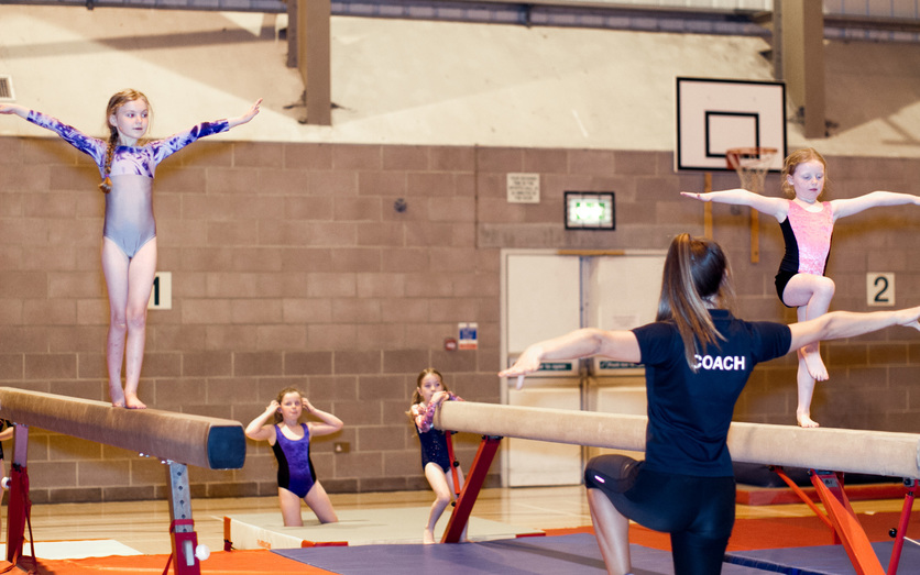 Girls on beam with instructor