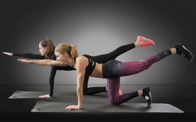 Ladies exercising on a mat