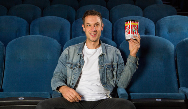 Man in cinema with popcorn